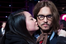Johnny Depp's wax figurine could have AIDS for all the lips that pass these cheeks